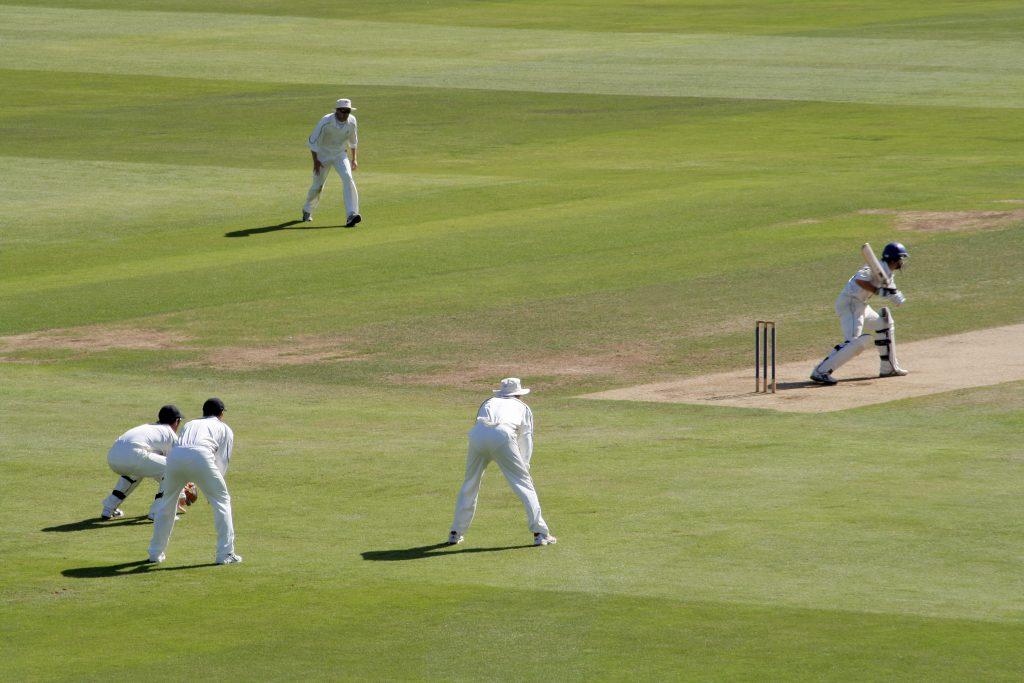 Fielders behind the batsman during cricket match