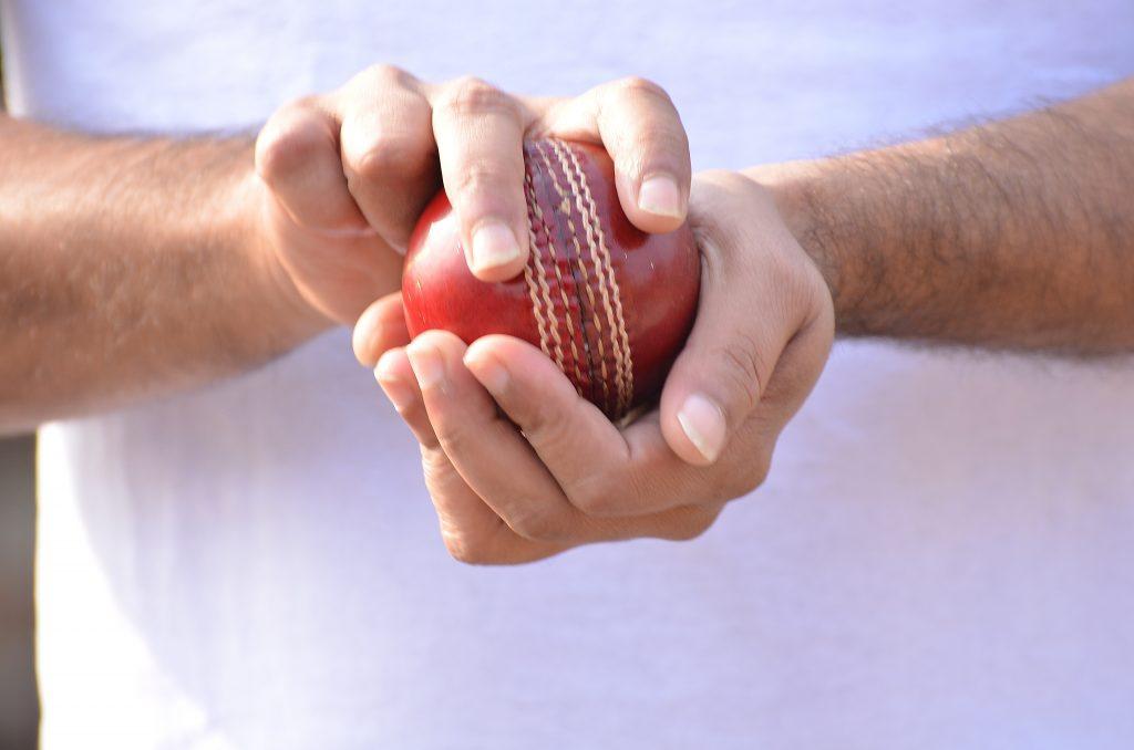 Cricket bowler prepares a delivery