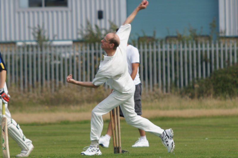 Cricket bowler making a delivery